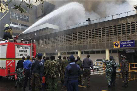 Fire fighters struggle to put out a fire at the Jomo Kenyatta International Airport in Kenya's capital Nairobi