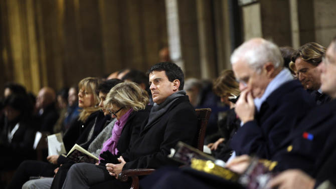 French interior minister Manuel Valls, center, attends a ceremony at  Paris' Notre Dame Cathedral for its 850th anniversary , Wednesday, Dec. 12, 2012. Paris' Notre Dame Cathedral is kicking off its 850th anniversary celebrations, which will include new bells for the medieval landmark, cast in a foundry in Normandy. (AP Photo/Christophe Ena)