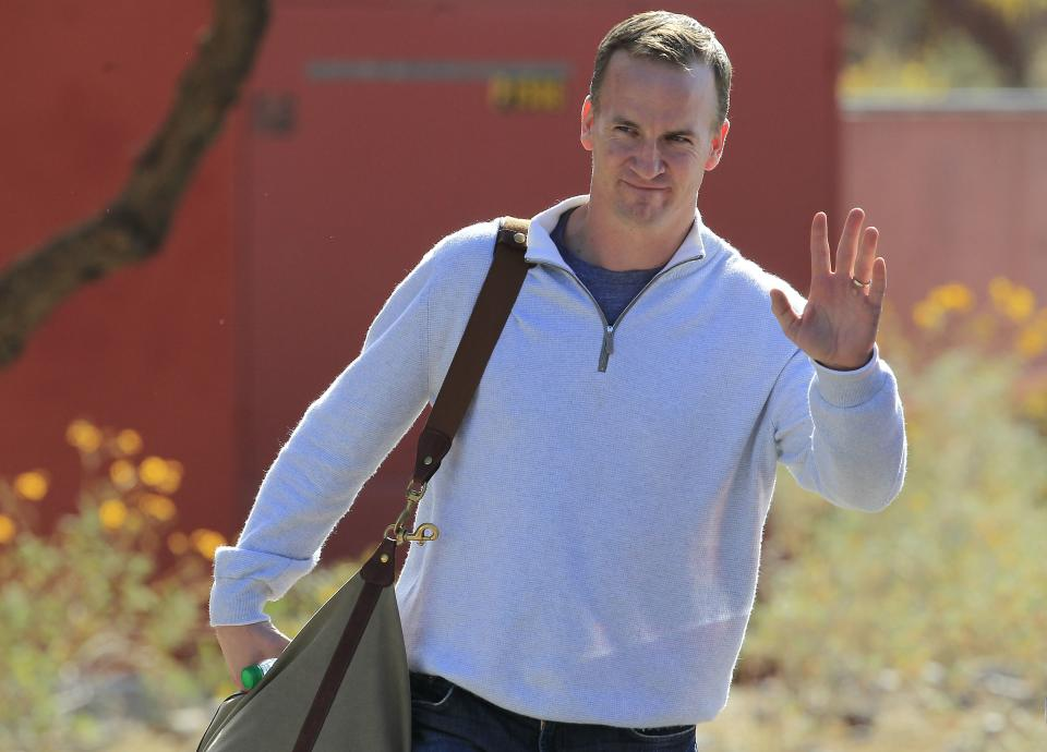 NFL quarterback Peyton Manning leaves the Arizona Cardinals training facility after a five hour meeting with coaches and front office staff Sunday, March 11, 2012, in Tempe, Ariz.(AP Photo/Ross D. Franklin)