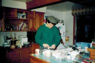 Kitchen, Before. John cracking eggs beside the sink. It took no less than five steps to walk from the sink to the dishwasher to load dripping dishes. Another floor-plan misfire.