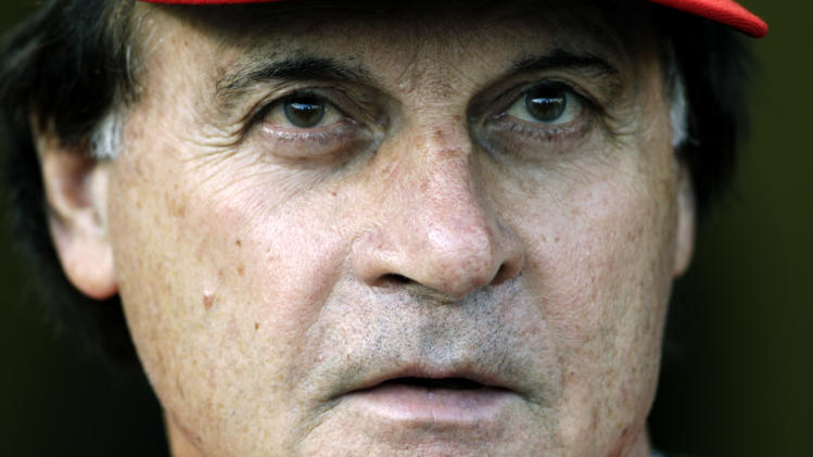 St. Louis Cardinals manager Tony La Russa watches batting practice before Game 4 of baseball's World Series against the Texas Rangers, Sunday, Oct. 23, 2011, in Arlington, Texas. (AP Photo/Paul Sancya)