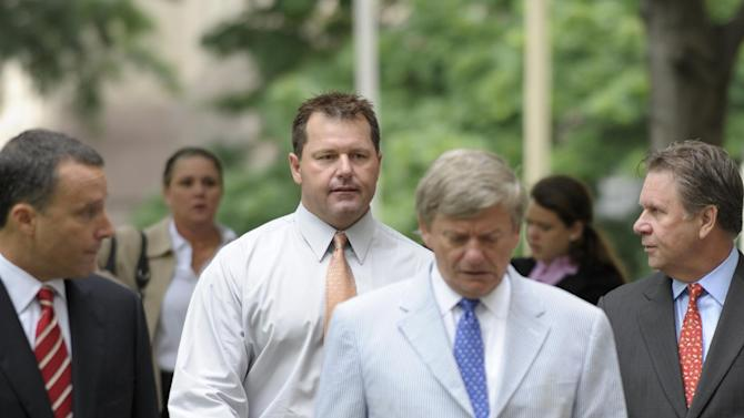 Former Major League baseball pitcher Roger Clemens, center, and his legal team, arrive at federal court in Washington, Wednesday, May 30, 2012. (AP Photo/Susan Walsh)