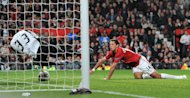 Javier Hernandez scores his first of two goals at Old Trafford