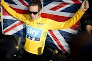 Cyclist Bradley Wiggins celebrates his win at the end 2012 Tour de France, in Paris, on July 22, 2012. Wiggins has been named BBC Sports Personality of the Year at a star-studded live ceremony in London