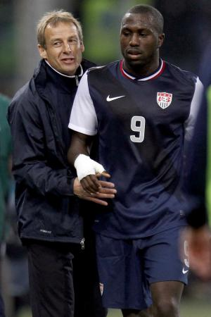 """FILE - In this Feb. 29, 2012, file photo, United States forward Jozy Altidore (9) is congratulated by head coach Jurgen Klinsmann as he leaves the field during a friendly soccer match against Italy in Genoa, Italy. Altidore was dropped Monday, Oct. 8, from the U.S. roster for critical World Cup qualifiers. Klinsmann was critical in an espn.com interview published Sept. 28, saying, """"I think Jozy can do a lot better, and he knows that."""" (AP Photo/Luca Bruno, File)"""