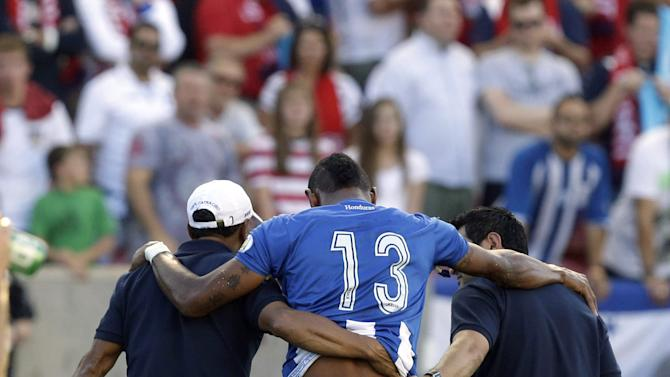 Honduras' Carlo Costly (13) is helped off the field after being injured in the first half during a World Cup qualifying soccer match against the United States, at Rio Tinto Stadium on Tuesday, June 18, 2013, in Sandy, Utah. (AP Photo/Rick Bowmer)