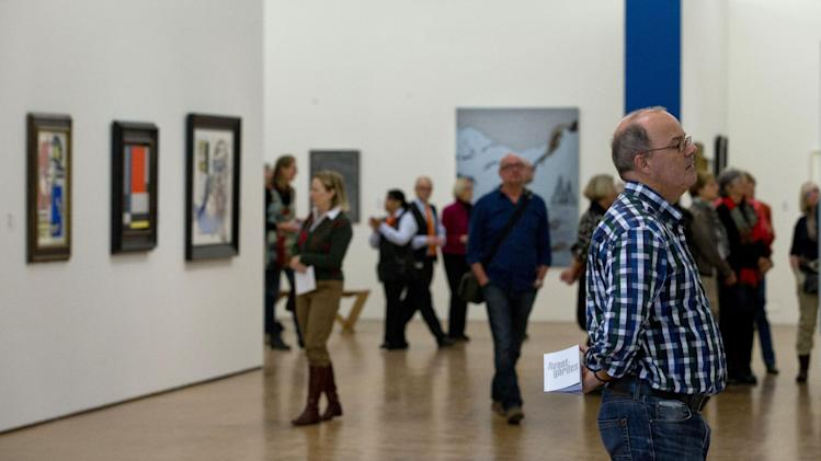 A man admiring a painting holds the catalogue of the Avant-gardes exhibit as the Kunsthal museum reopened its doors to the public following an art heist in Rotterdam, Wednesday Oct. 17, 2012. Police investigating a multimillion euro (dollar) art heist on early Tuesday morning Oct. 16, 2012, say they are following up several tips from the public, a day after thieves grabbed seven paintings from the walls of a Rotterdam gallery and vanished into the night. A spokeswoman for detectives on the case, Willemieke Romijn, said Wednesday they have some 15 tips from the public, following a late-night, nationally televised appeal for witnesses to the theft from the Kunsthal gallery of works by celebrated artists including Pablo Picasso, Claude Monet and Henri Matisse. (AP Photo/Peter Dejong)