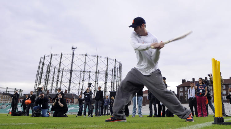 Chicago Bears' Jay Cutler tries his hand at cricket during a team training session at the Oval cricket ground, London, Friday Oct. 21, 2011. The Bears will face the Tampa Bay Buccaneers at London's Wembley stadium on Sunday. (AP Photo/Tom Hevezi)