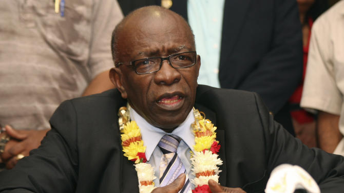 FILE - In this June 2, 2011 file photo, uspended FIFA executive Jack Warner speaks during a news conference held shortly after his arrival at the airport in Port-of-Spain, in his native Trinidad and Tobago. The Confederation of North, Central American and Caribbean Association Football (CONCACAF) ethics and integrity committee accuses Warner and its former secretary general Chuck Blazer of enriching themselves through fraud, in a 100-page report presented at the organization's congress in Panama City, Friday, April 20, 2013, with FIFA President Sepp Blatter in attendance.  (AP Photo/Shirley Bahadur, File)