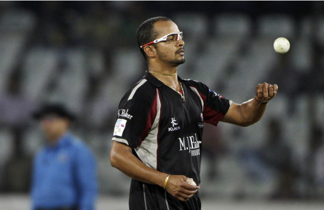 Somerset bowler Murali Kartik spins the ball during the Champions League Twenty20 cricket qualifying match between Somerset and Auckland in Hyderabad, India, Tuesday, Sept. 20, 2011. (AP Photo/Mahesh