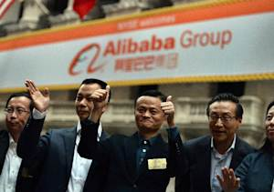 Alibaba CEO Jack Ma gives two thumbs up as he arrives …