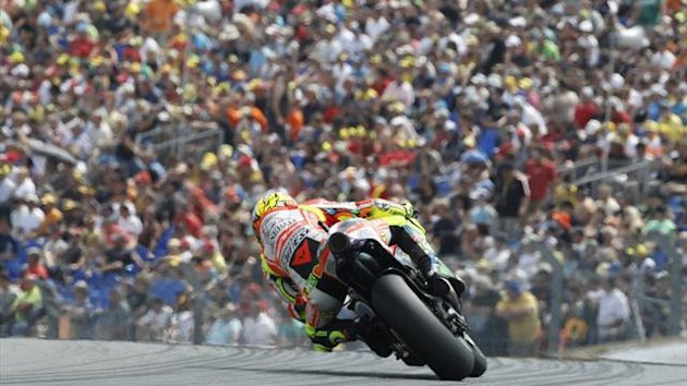 Ducati MotoGP rider Valentino Rossi of Italy rides during the qualifying round of the German Grand Prix at the Sachsenring circuit