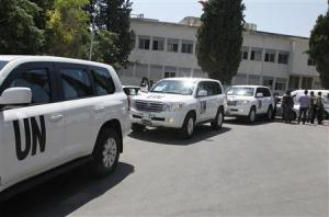 U.N. vehicles, carrying United Nations chemical weapons experts, arrive at Yousef al-Azma military hospital in Damascus