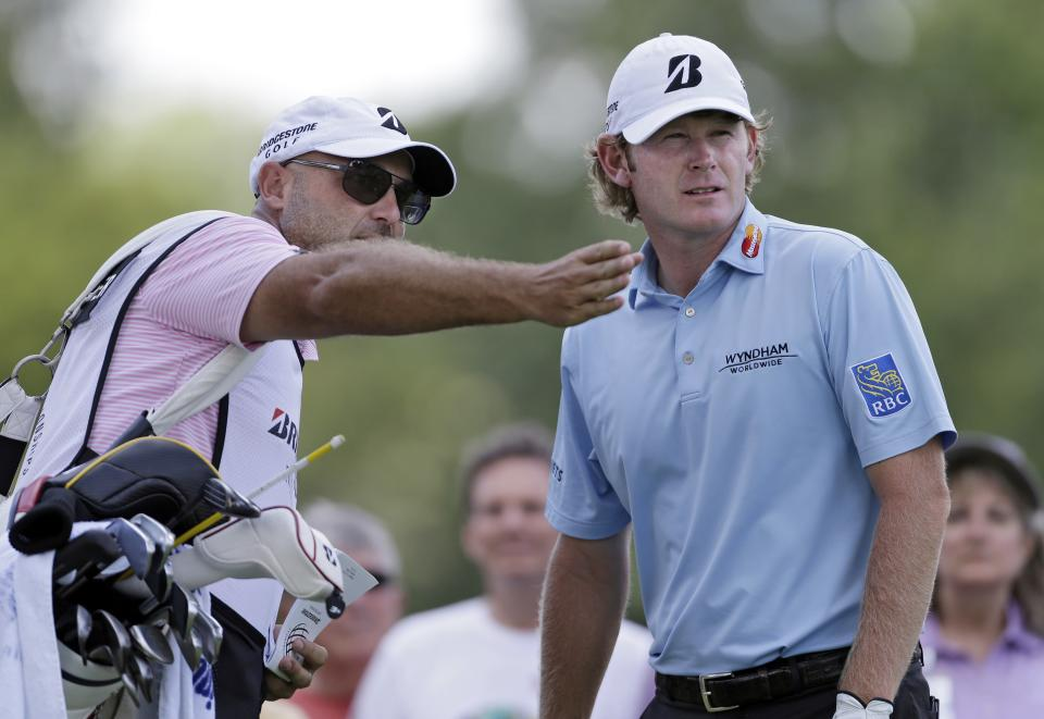 Caddie Scott Vail, left, confers with Brant Snedeker on the 11th tee during the first round of the Bridgestone Invitational golf tournament Thursday, Aug. 1, 2013 at Firestone Country Club in Akron, Ohio. (AP Photo/Mark Duncan)