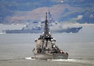 Japanese Maritime Self-Defense Force's Aegis guided-missile destroyers, Kongo (front) and Chokai, are seen leaving their base in Sasebo, Nagasaki Prefecture to head out to sea, in 2009. Defence Minister Naoki Tanaka said in Tokyo on Friday he has ordered troops to shoot down the N.Korean rocket if it threatens Japanese territory