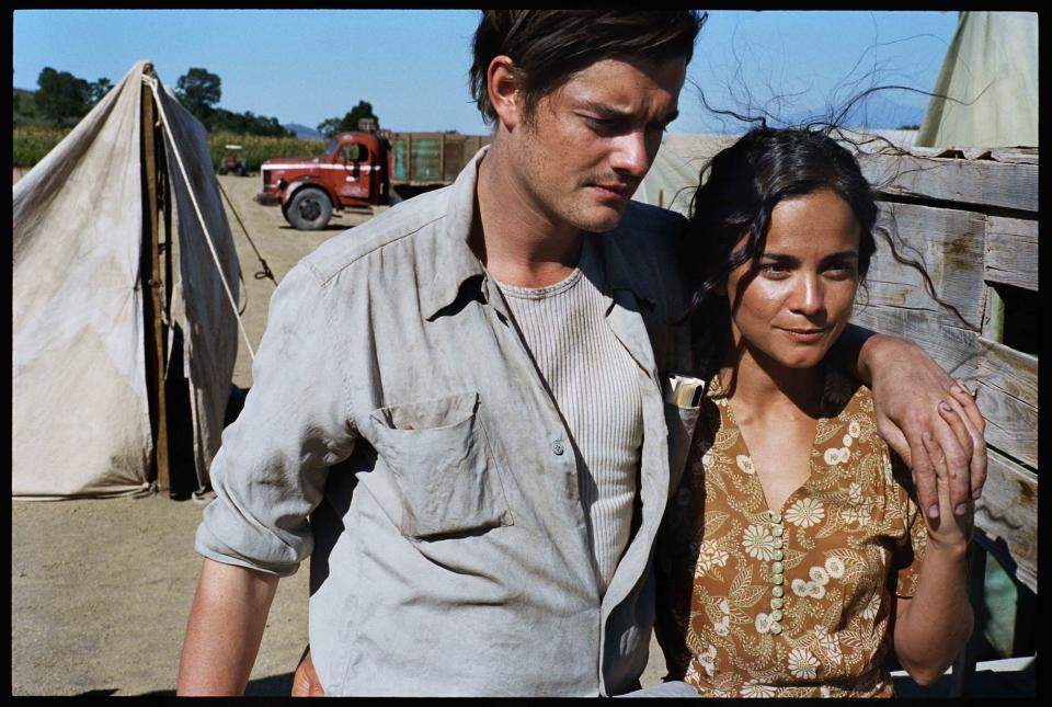 "This undated publicity film image released by IFC Films/Sundance Selects shows Sam Riley, left, as Sal Paradise/Jack Kerouac and Alice Braga, as Terry/Bea Franco in a scene from the film, ""On the Road,"" directed by Walter Salles. (AP Photo/IFC Films/Sundance Selects, Gregory Smith)"