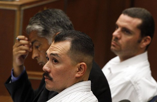 Marvin Norwood, right, his attorney Victor Escobedo and co-defendant Louie Sanchez listen during preliminary proceedings on Friday, June 8, 2012 in Los Angeles County Superior Court. The transcript of the talk between Louie Sanchez, 30, and co-defendant Marvin Norwood, 31, was released after a preliminary hearing where both men were ordered to stand trial on charges of mayhem, assault and battery in the 2011 attack on Bryan Stow. The men spoke after they had appeared in a lineup. (AP Photo/Los Angeles Times, Irfan Khan, Pool)