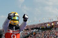 McLaren Mercedes' British driver Lewis Hamilton celebrates celebrates a win in July. The team boss said the Formula One title race is still wide open