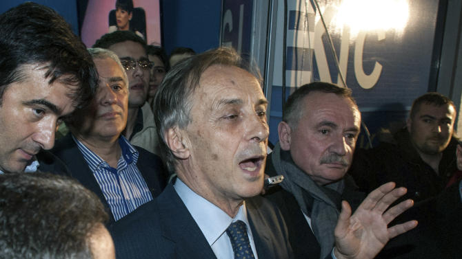 Presidential candidate Miodrag Lekic addresses his supporters after his headquarters claimed victory in Podgorica, Montenegro, Sunday, April 7, 2013. Both the incumbent and the opposition candidate claimed victory in Montenegro's presidential election on Sunday, fueling political tensions in the small Balkan country which is striving for European Union membership. State election authorities had yet to release any official results in the race for the largely ceremonial post. President Filip Vujanovic, from the ruling Democratic Party of Socialists, said that based on his camp's own, full count of the votes, he had won 51.3 percent of ballots, while opponent Lekic won 48.7 percent. (AP Photo/Risto Bozovic)