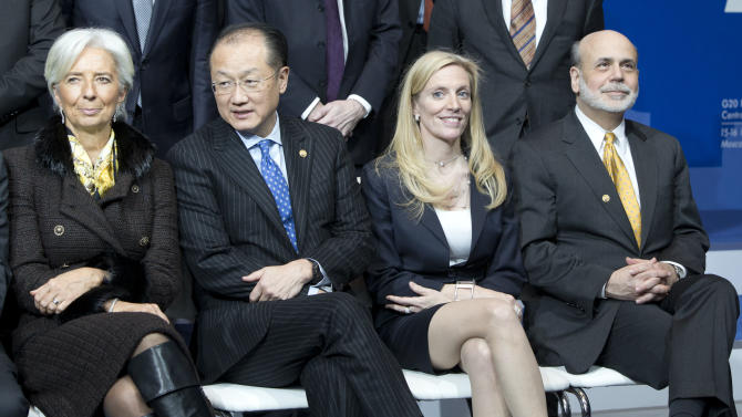From right, Chairman of the U.S. Federal Reserve Ben Bernanke, Undersecretary of International Affairs at the U.S. Treasury Department Lael Brainard, World Bank President Jim Yong Kim and Chief of the International Monetary Fund Christine Lagarde attend a group photo ceremony at a meeting of G20 Finance Ministers and Central Bank Governors  in Moscow, Russia, Saturday, Feb. 16, 2013. (AP Photo/Misha Japaridze)