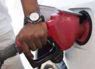 A person pumps fuel in Toronto on September 12, 2012. THE CANADIAN PRESS/Michelle Siu