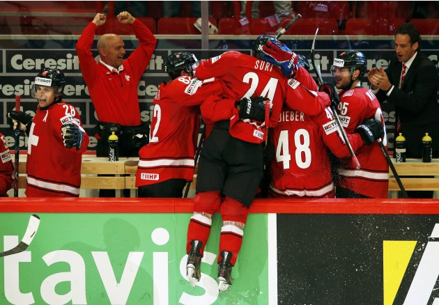 Switzerland's Suri celebrates scoring the winning goal against Team USA with his teammates on the bench during their 2013 IIHF Ice Hockey World Championship semi-final match at the Globe Arena in Stoc