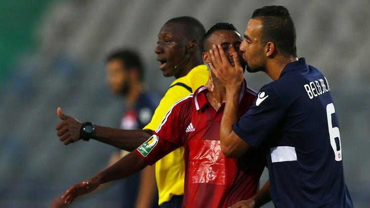 Mouihbi of Etoile du Sahel kisses Ashour of Al-Ahly after he was substituted during their CAF confederation cup soccer match in Cairo