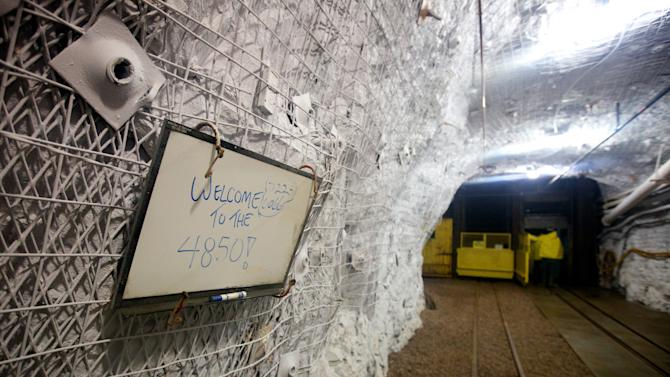 A sign welcomes visitors to a lab 4,850 feet beneath the earth on Wednesday, May 30, 2012. The Sanford Underground Research Facility in Lead, S.D., will house the world's most sensitive dark-matter detector. Scientists say that the lab _ housed inside the now-shuttered Homestake Gold Mine _ could help scientists understand the origins of the universe. (AP Photo/Amber Hunt)