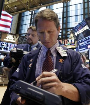 Trader Robert Charmak, right, on the floor of the New York Stock Exchange Friday, July 5, 2013. World stock markets eked out moderate gains Friday, July 12, 2013 building on a rally sparked by the Fed's vow to continue supporting the U.S. economy, as investors awaited the latest growth figures from China. (AP Photo/Richard Drew)
