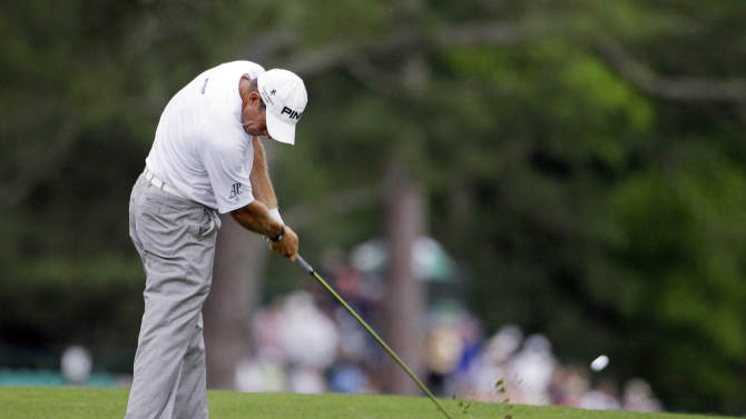 Lee Westwood, of England, hits his second shot on the 15th hole during the first round the Masters golf tournament Thursday, April 5, 2012, in Augusta, Ga. (AP Photo/Darron Cummings)