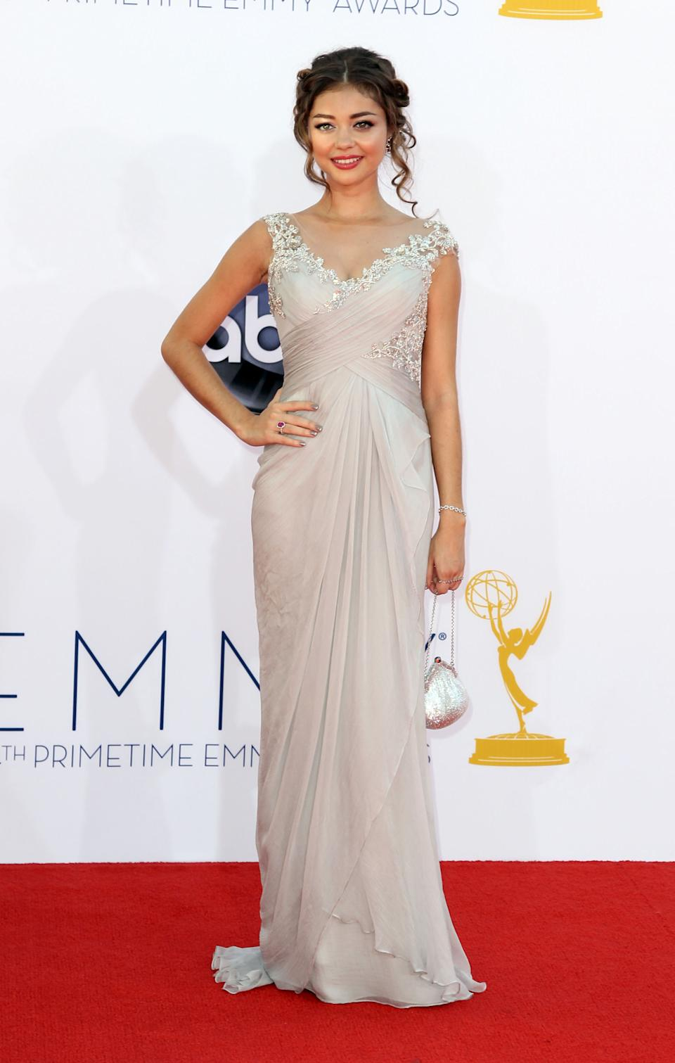 "Sarah Hyland from ""Modern Family,"" arrives at the 64th Primetime Emmy Awards at the Nokia Theatre on Sunday, Sept. 23, 2012, in Los Angeles. (Photo by Matt Sayles/Invision/AP)"