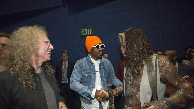 """Cast member Benjamin greets musician Tyler, as film composer Wachtel stands nearby, at a special screening of """"Jimi: All Is by My Side"""" at the ArcLight theatre in Los Angeles"""