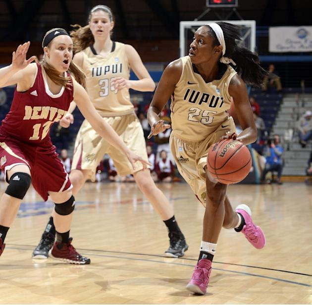 IUPUI's DeAirra Goss dribbles past Denver's Jacqlyn Poss in the first half of Monday's semifinal game of the Summit League conference tournament, March 10, 2014 in Sioux Falls, S.D. Denver
