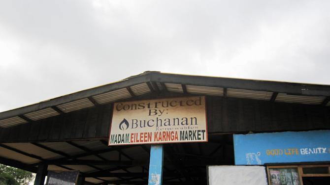 In photo taken Dec. 2014, a market in Buchanan, Liberia constructed by Buchanan Renewables – one of the few signs remaining of the company's presence in the city. Its Liberian biomass project, backed by the U.S. Overseas Private Investment Corporation, collapsed. A failed U.S. government-backed plan to produce environmentally friendly energy in one of Africa's poorest countries was marred by insider connections and questionable planning, an Associated Press investigation found. The federal agency at the center of the deal is one of the government's biggest secrets and routinely escapes public scrutiny. That agency, the Overseas Private Investment Corporation, approved three loans totaling $217 million to help a company, Buchanan Renewables, convert nonproducing rubber trees into biomass chips that would help power Liberia. (AP Photo/Jonathan Paye-Layleh)