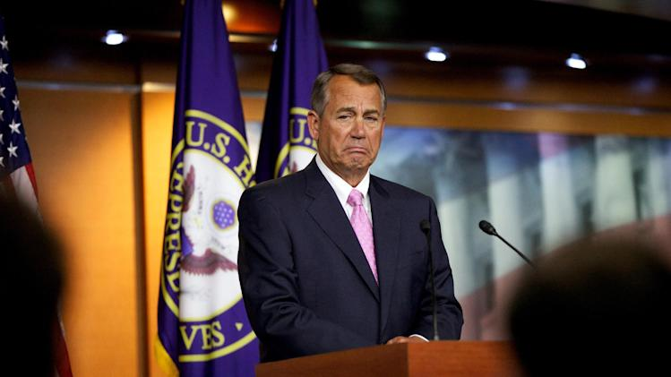 House Speaker John Boehner of Ohio listens to a reporter's question during a news conference in the U.S. Capitol in Washington, Thursday, Nov. 14, 2013. Speaking about the Affordable Care Act, Boehner insisted it was time to