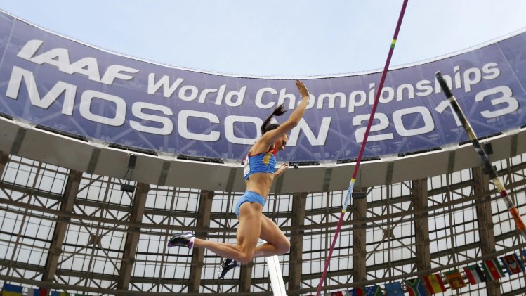 Isinbaeva of Russia competes in the women's pole vault qualifying round during the IAAF World Athletics Championships at the Luzhniki stadium in Moscow