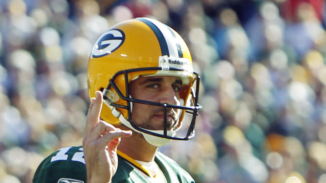 Green Bay Packers quarterback Aaron Rodgers reacts after fullback John Kuhn ran for a first down in the final seconds of the second half of an NFL football game against the Detroit Lions Sunday, Oct. 3, 2010, in Green Bay, Wis. The Packers won 28-26. (AP Photo/Mike Roemer)