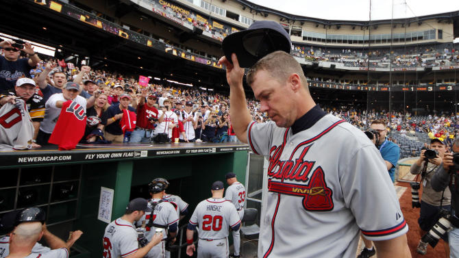 Atlanta Braves' Chipper Jones acknowledges fans as he heads for the locker room following a 4-0 win over the Pittsburgh Pirates in the final game of the regular baseball season in Pittsburgh, Wednesday, Oct. 3, 2012. (AP Photo/Gene J. Puskar)