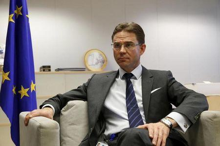 European Commission Vice-President Jyrki Katainen, responsible for Jobs, Growth, Investment and Competitiveness, reacts during a Reuters interview in Brussels