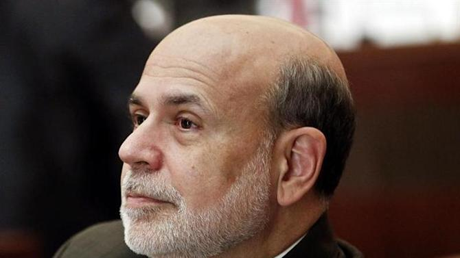 "Ben Bernanke, chairman of the Federal Reserve, listens to a presentation during the ""Community Banking in 21st Century"" conference at the Federal Reserve Bank of St. Louis in St. Louis"