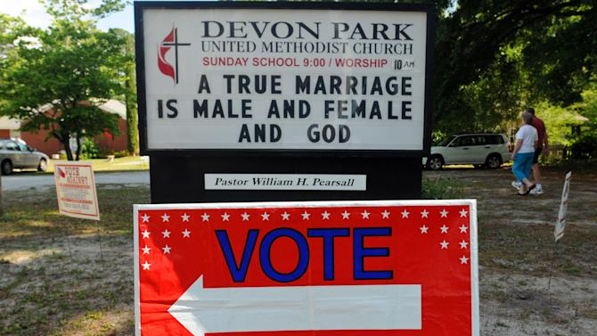 A sign displays a message opposed to gay marriage in front of the Devon Park United Methodist Church polling site on Tuesday, May 8, 2012, in Wilmington, N.C. North Carolina could be the next state to pass a constitutional amendment defining marriage as solely between a man and a woman. Voters are casting their ballots Tuesday. (AP Photo/The Star-News, Ken Blevins)