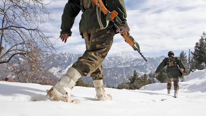 "Indian army soldiers patrol near the Line of Control (LOC), the line that divides Kashmir between India and Pakistan, in Churunda village, about 150 Kilometers (94 miles) northwest of Srinagar, India, Tuesday, Jan. 15, 2013. India's relations with archrival Pakistan ""cannot be business as usual"" in the wake of a spate of attacks in Kashmir, Prime Minister Manmohan Singh said Tuesday in a statement that threatens to ratchet up tensions in the wake of the Himalayan violence. A series of tit-for-tat attacks, including the beheading of an Indian soldier, across the LOC that divides the Himalayan region has killed two Pakistani and two Indian soldiers over the past 10 days. (AP Photo/Mukhtar Khan)"