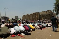 Egyptian supporters of president-elect Mohamed Morsi perform noon prayers in Cairo's Tahrir Square. Morsi is drawing up a battle plan to confront Egypt's economic and security crises as he pushed ahead with selecting a government of technocrats, a senior aide told AFP