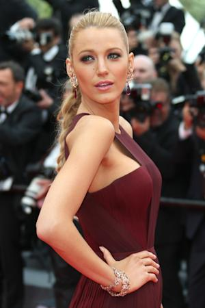 American actress Blake Lively poses for photographers on the red carpet during the opening ceremony and the screening of Grace of Monaco at the 67th international film festival, Cannes, southern France, Wednesday, May 14, 2014. (Photo by Joel Ryan/Invision/AP)