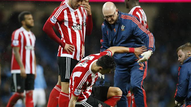 Southampton's Jose Fonte receives treatment after sustaining an injury