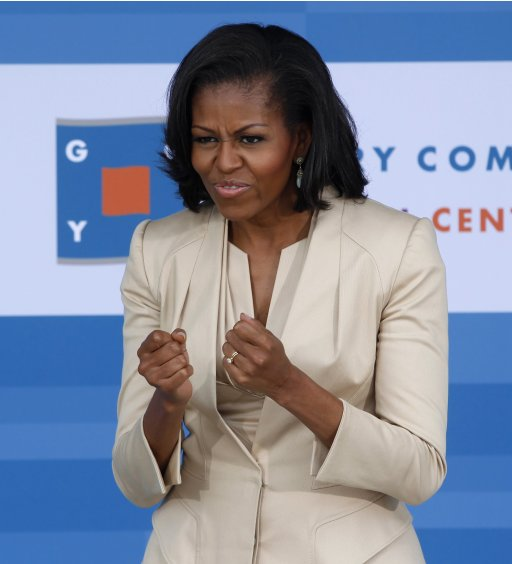 First lady Obama reacts to question about her dressmaker before greeting NATO leaders' spouses and companions for tour of Gary Comer Youth Center in Chicago