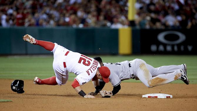New York Yankees' Didi Gregorius, right, collides with Los Angeles Angels second baseman Johnny Giavotella after trying to advance on a ball hit by Chris Young during the seventh inning of a baseball game in Anaheim, Calif., Monday, June 29, 2015. (AP Photo/Chris Carlson)