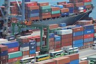 A general view shows containers waiting to be loaded onto cargo ships at Keelung Harbor in northern Taiwan. Shrinking overseas demand for information technology and telecom products has led to a year-on-year decline of 11.6 percent in Taiwan's export in July, the government says
