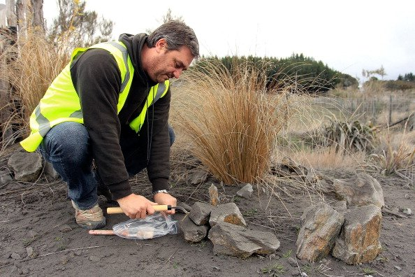 Dr Jon Procter from Massey University collects an ash sample after Mt Tongariro erupted for the first time in over 100 years on August 7, 2012 in Tongariro National Park, New Zealand. Mt Tongariro eru