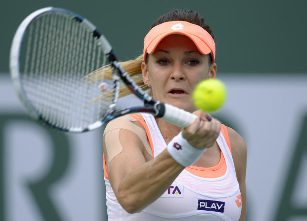 Agnieszka Radwanska, of Poland, returns a shot to Alize Cornet, of France, in their fourth round match at the BNP Paribas Open tennis tournament, Tuesday, March 11, 2014, in Indian Wells, Calif. (AP P